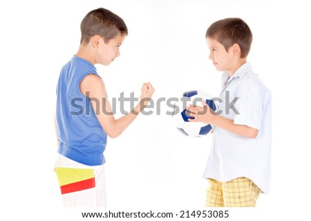little boys fighting over soccer ball isolated in white - stock photo