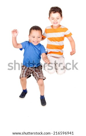 little boys jumping isolated in white - stock photo