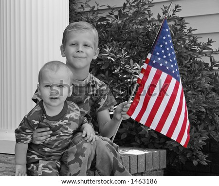 Little boys playing soldier - stock photo