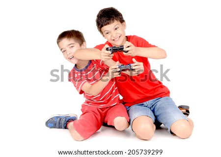 little boys playing videogames isolated in white - stock photo