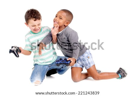 little boys playing videogames isolated in white