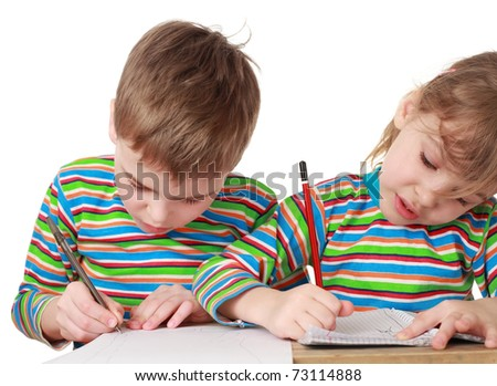 little brother and sister drawing, pencil, pen and notebook on table - stock photo