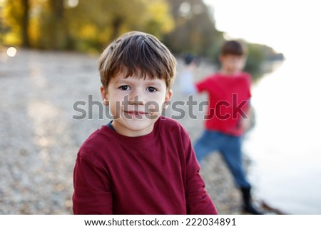 Little brothers in nature, happy family, playing outdoor - stock photo
