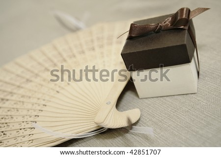 little brown box with a wooden fan - stock photo