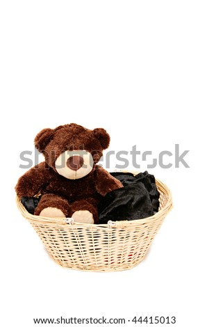 little, brown teddy bear sitting in the basket - stock photo