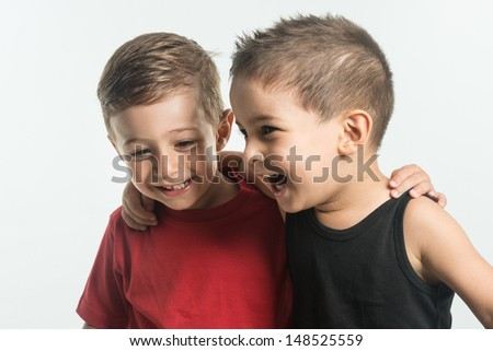 Little buddies talking and laughing - stock photo