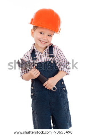 Little builder in coveralls and helmet with wrench, isolated on white - stock photo