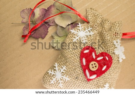 little burlap bags with christmas decorations