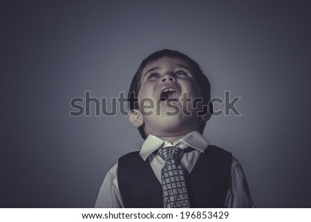 little business boy over grey background - stock photo