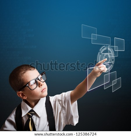 Little business boy pressing digital button