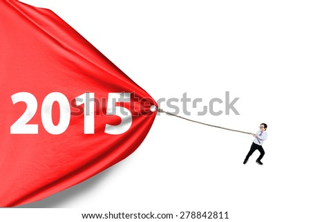 Little business person pulling a big banner with number 2015, isolated over white background - stock photo
