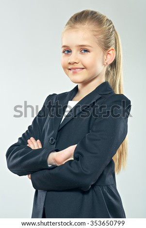 Little business woman portrait with crossed arms. Child girl in business style. Smiling girl. - stock photo
