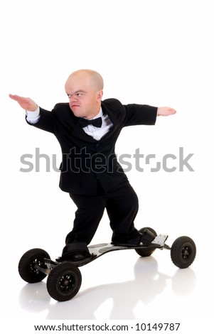 Little businessman, dwarf in a formal suit with bow tie surfing on skateboard, mountain board, studio shot, white background