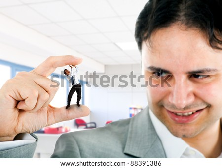 Little businessman getting crushed by a big bad man - stock photo