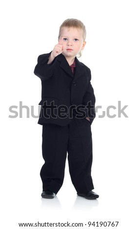 Little businessman isolated on the white shows finger