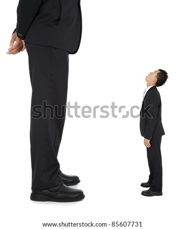 Little businessman looked at a giant businessman - stock photo