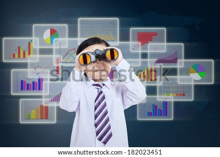 Little businessman see vision using binoculars in front of business futuristic background - stock photo