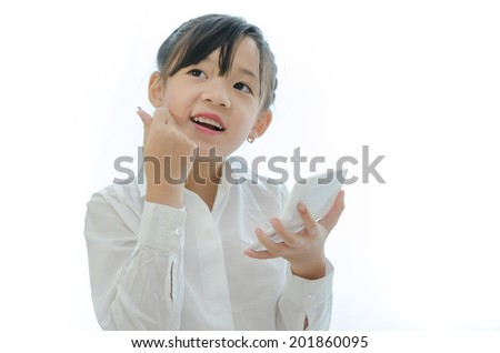 Little butiful asian girl first make up - stock photo