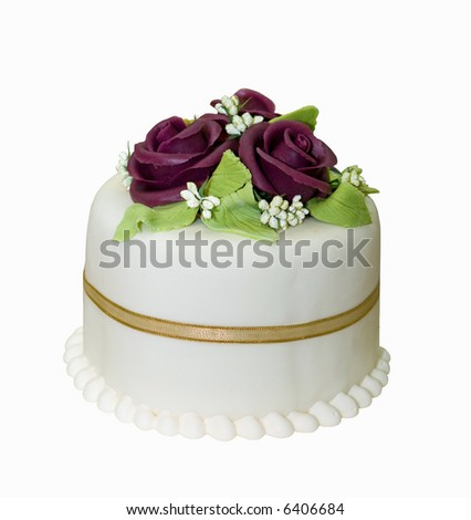 Little cake with white icing decorated with marzipan roses - stock photo