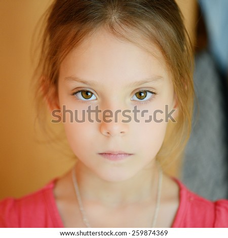 Little calm girl in red dress. - stock photo