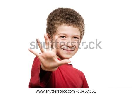 little caucasian boy portrait saluting isolated studio on white background - stock photo