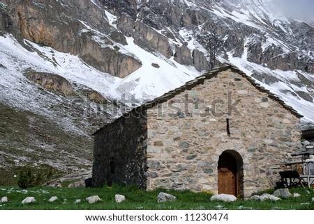 Little chapel attached to the mountain near Pralognan en Vanoise (France) - stock photo