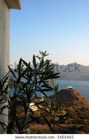little chapel in the distance in an island in Greece - stock photo