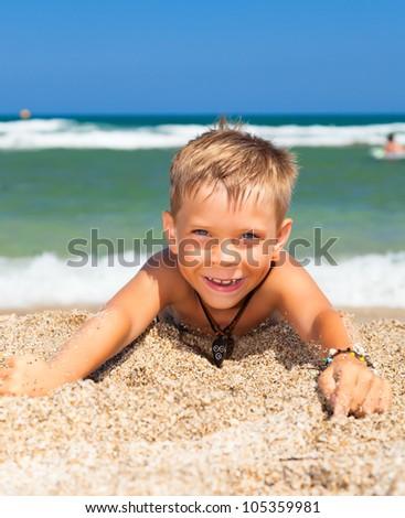 little cheerful boy on the beach - stock photo