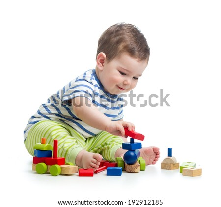 little cheerful child playing  with construction set - stock photo