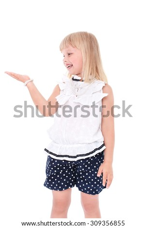 Little cheerful girl schoolgirl isolated on a white background with an outstretched hand - stock photo