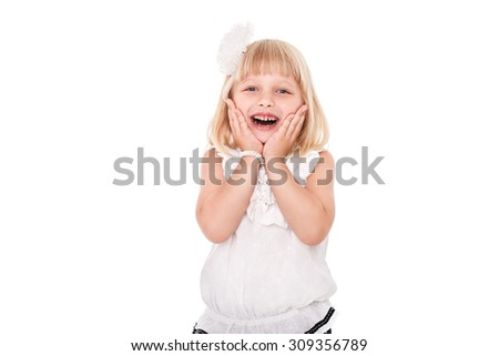 Little cheerful girl schoolgirl isolated on white background with surprised emotion - stock photo