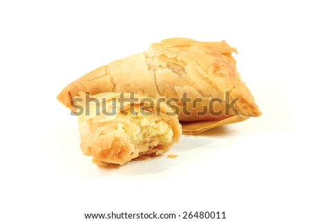 little cheese pies isolated in white from greek traditional cuisine