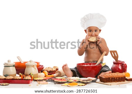 Little Chef.  Adorable biracial baby wearing a chef's hat and surrounded by baked goods.  Isolated on white with room for your text. - stock photo