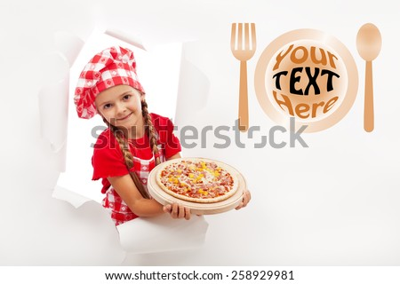 Little chef offering you a fresh pizza - leaning out from a hole in billboard, copyspace - stock photo