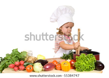 Little chef preparing healthy meal with lots of different vergetables - isolated - stock photo
