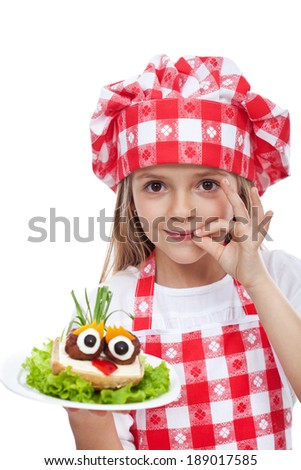 Little chef with creative food - onion hair on meatball eyed creature, isolated - stock photo