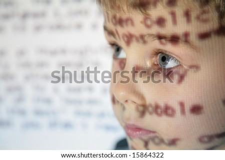 little child an text projection device - stock photo