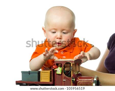 little child baby  closeup portrait isolated on white studio shot face playing with car - stock photo