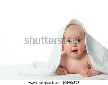 little child baby  closeup portrait isolated on white studio shot face under white towel - stock photo