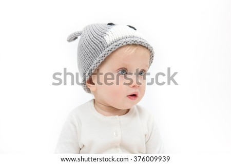 little child baby portrait in warm hat face isolated on white studio shot - stock photo
