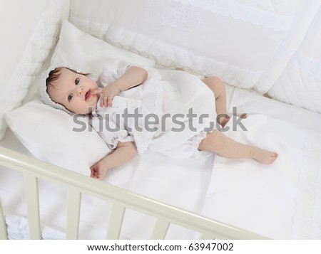 little child baby sleeping in bed