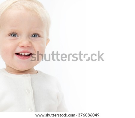 little child baby smiling portrait warm clothing isolated on white studio shot - stock photo