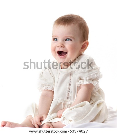 little child baby smiling sitting on white background