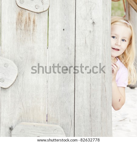 little child behind wooden board. See my portfolio for more - stock photo