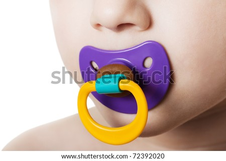 Little child boy and plastic baby soother pacifier