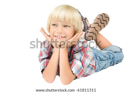 little child boy  lie on stomath and smile, on white background, isolated