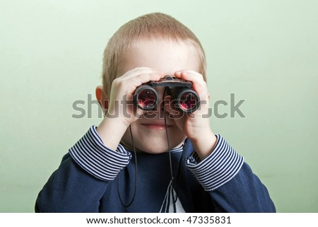 Little child boy looking binoculars lens isolated