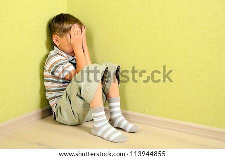 Little child boy wall corner punishment sitting - stock photo