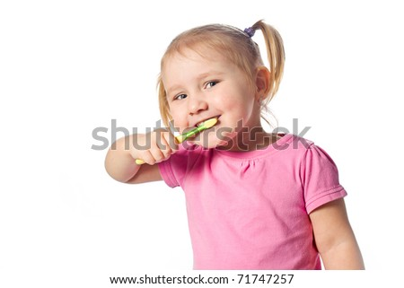 little child brush his teeth - stock photo