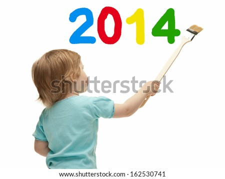 Little child drawing 2014 on a white wall with a paintbrush - stock photo